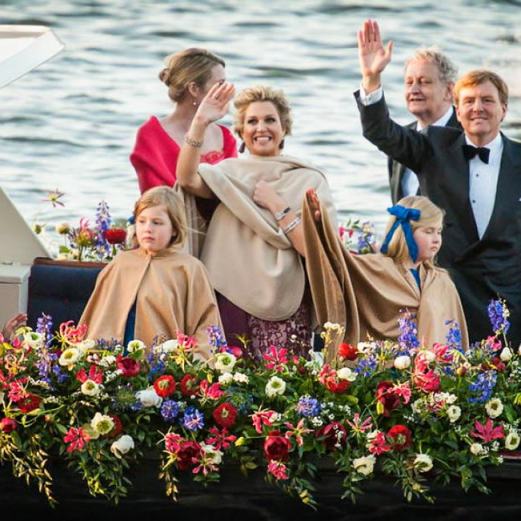 Royal couple on boat with gloriosa decorations